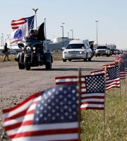 A procession of motorcycles and cars escort the hearse carrying the body of Sgt. Joseph Collette Wednesday, April 3, 2019, at Rickenbacker International Airport in Columbus.