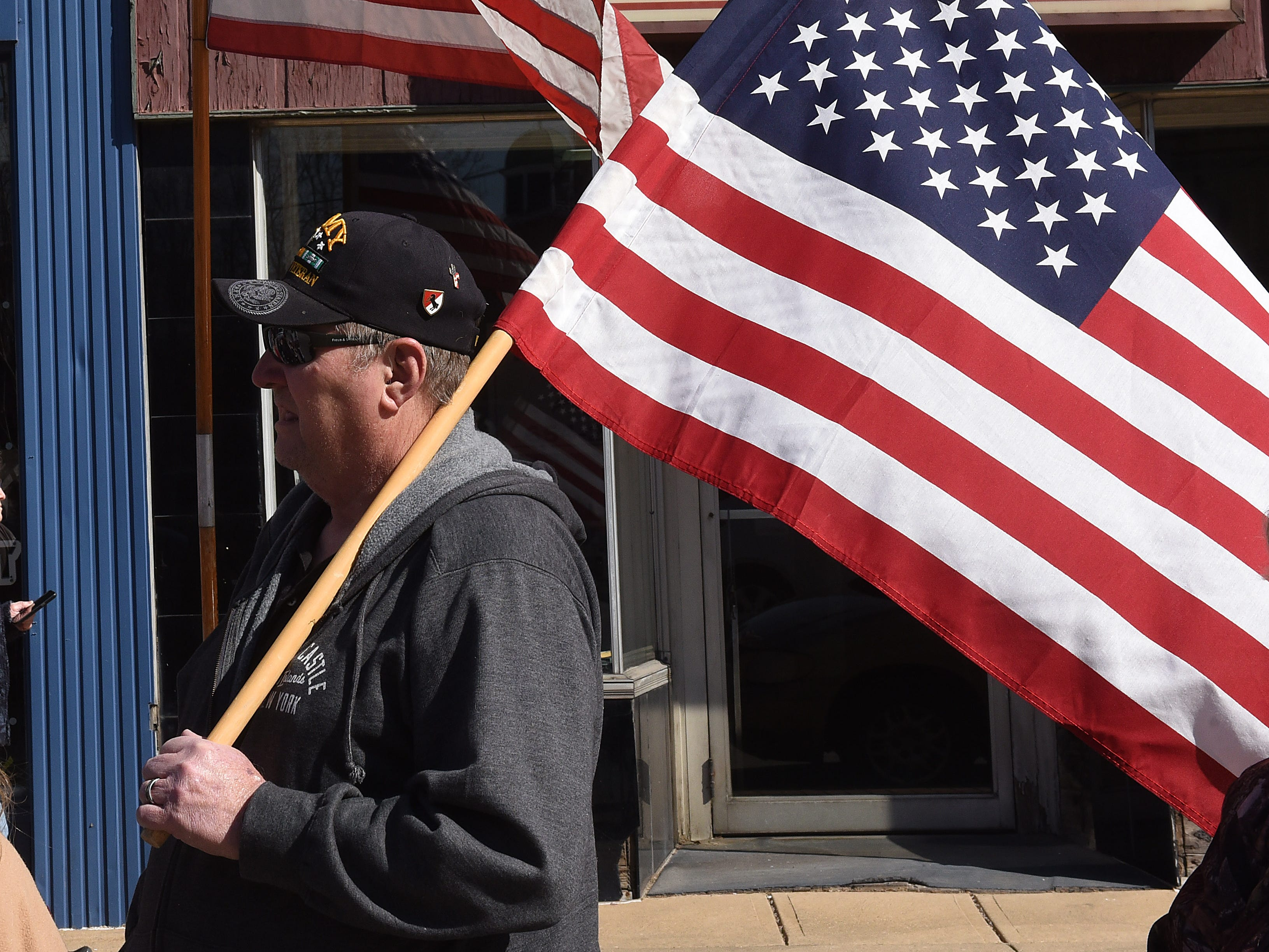 U.S. Army veteran Elon Van Fossen joins the crowd along Main Street for the funeral procession for U.S. Army Sgt. Joseph Collette in downtown Lancaster on Wednesday, April 3, 2019. Van Fossen said he felt proud to do this for the young man and his family.