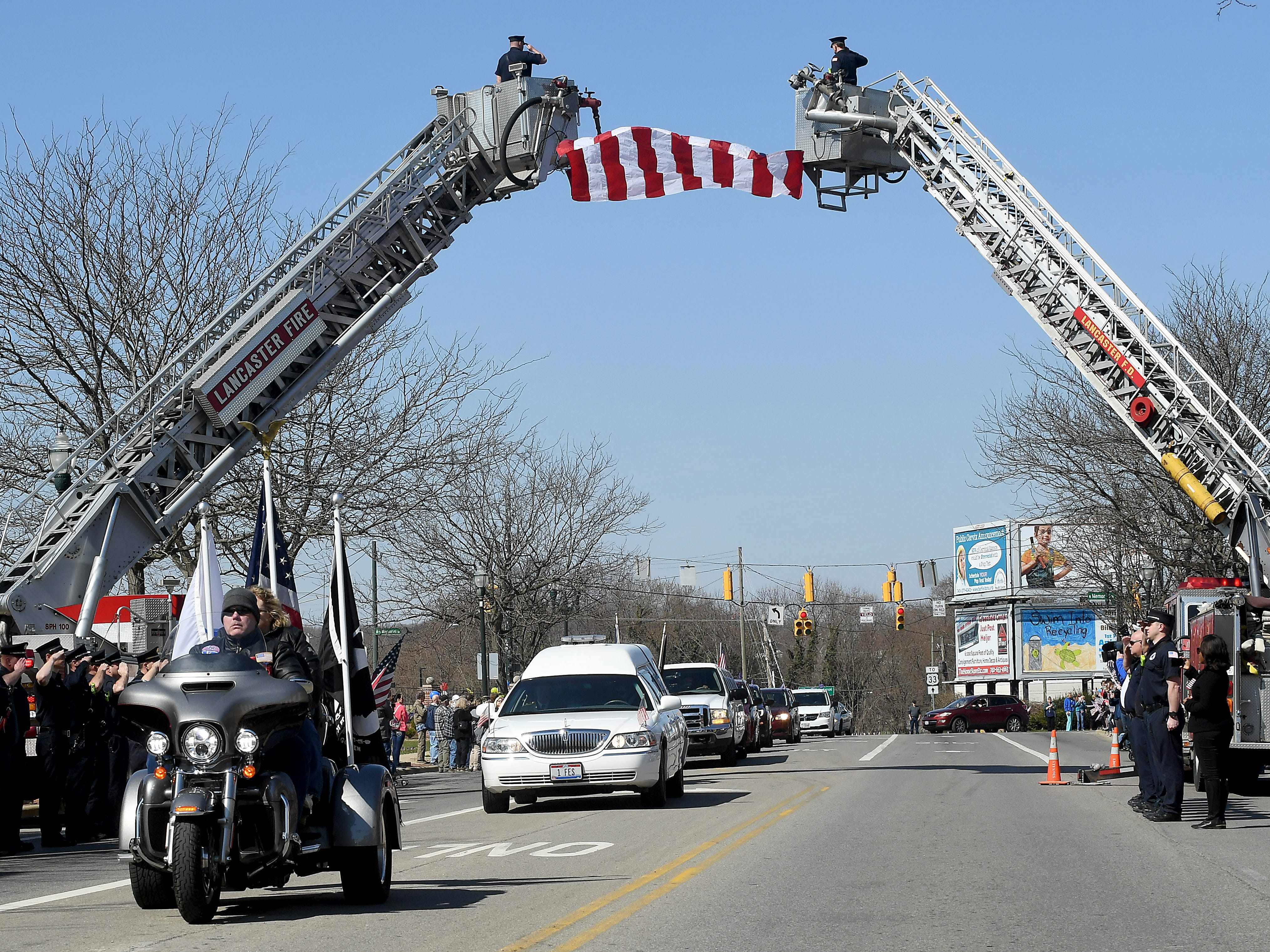 Patriot Guard Riders Richard and Anna Zimmerly lead the hearse carrying U.S. Army Sgt. Joseph Collette down Main Street in Lancaster on Wednesday, April 3, 2019.