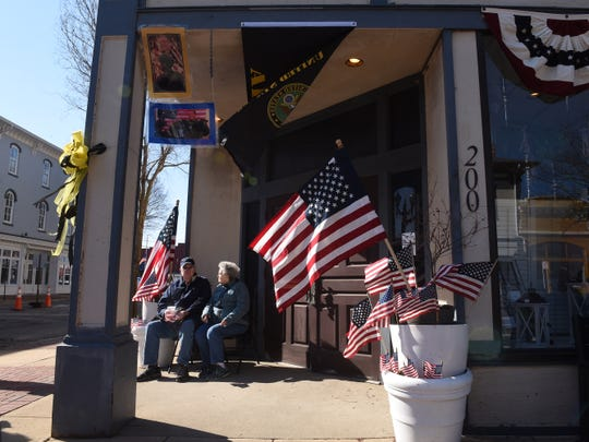 Ron and Loretta Rosser, of Lancaster, have a cup of coffee while waiting for the procession for U.S. Army Sgt. Joseph Collette to arrive in downtown Lancaster on Wednesday, April 3, 2019.