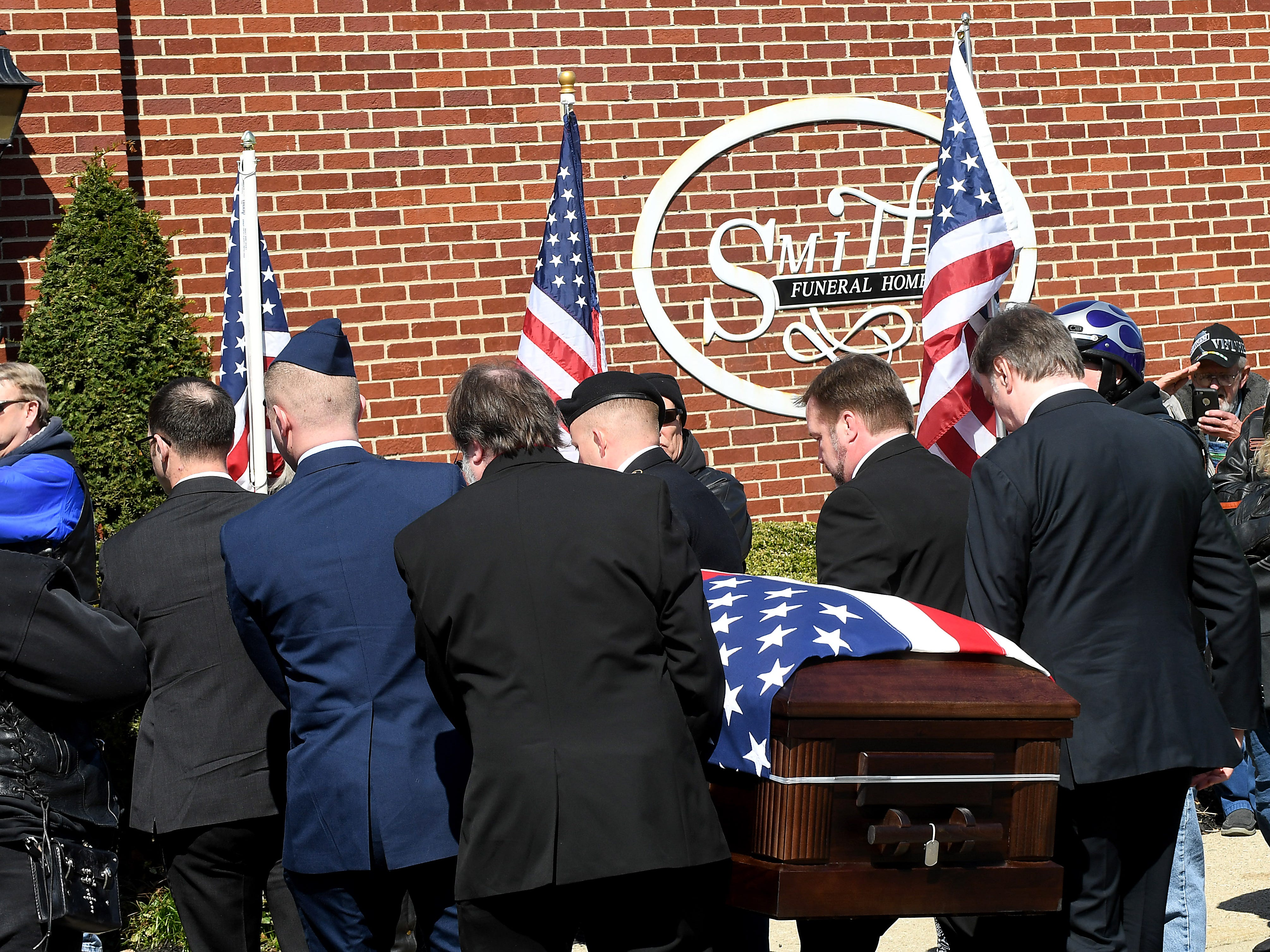 The casket of U.S. Army Sgt. Joseph Collette is carried in to the Frank E. Smith Funeral Home after a procession from Rickenbacker International Airport in Columbus.