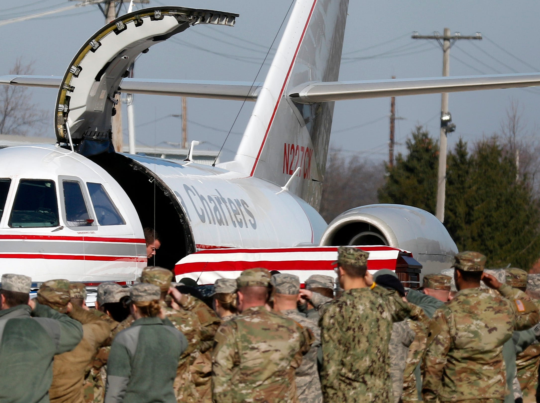 Military personnel salute as the casket of Sgt. Joseph Collette is unloaded from a plane Wednesday morning, April 3, 2019, at Rickenbacker International Airport in Columubs. Collette, 29, from Lancaster, was killed in combat March 21 in Afghanistan.
