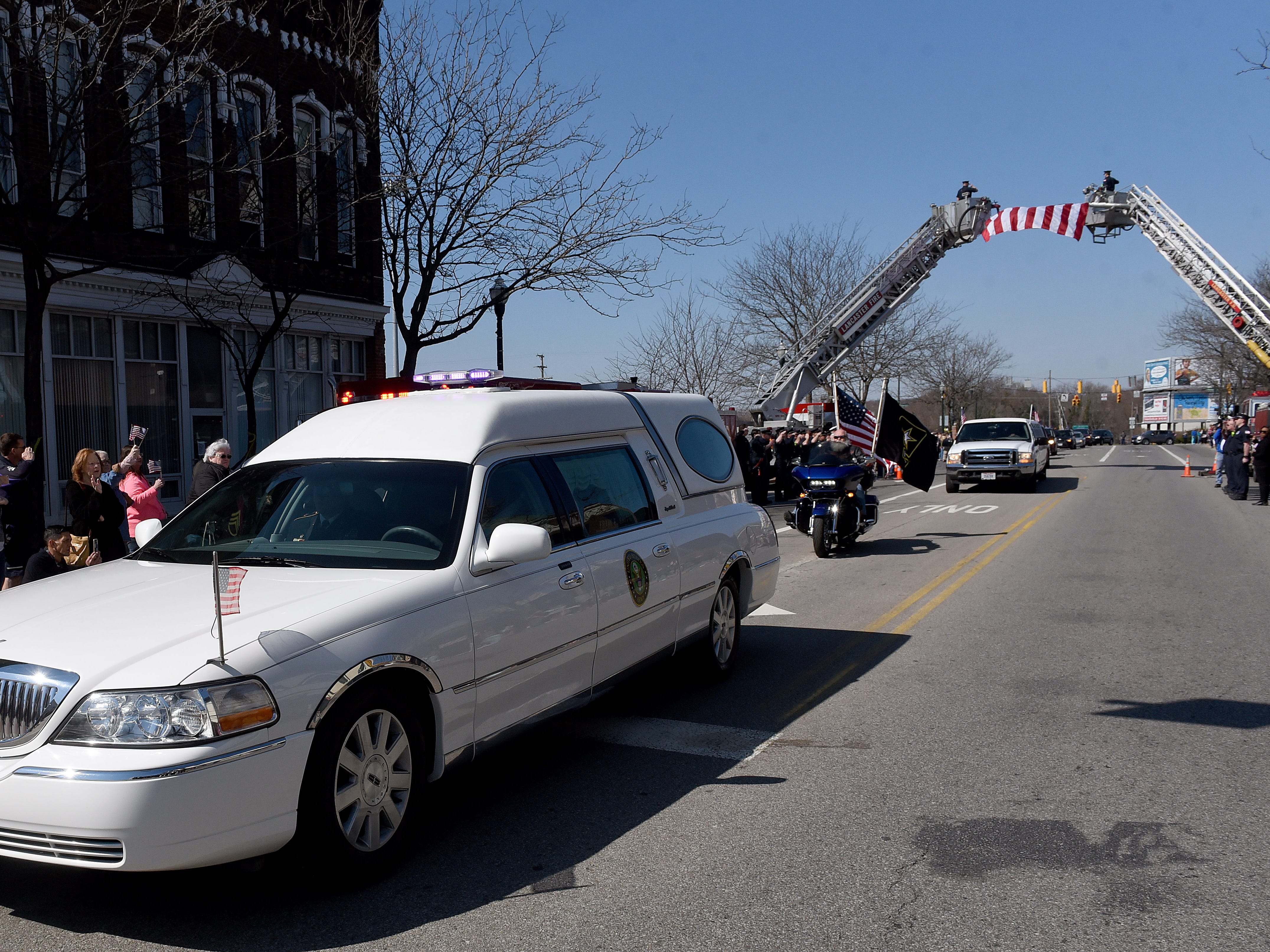 The hearse carrying U.S. Army Sgt. Joseph Collette down Main Street in Lancaster on Wednesday, April 3, 2019.