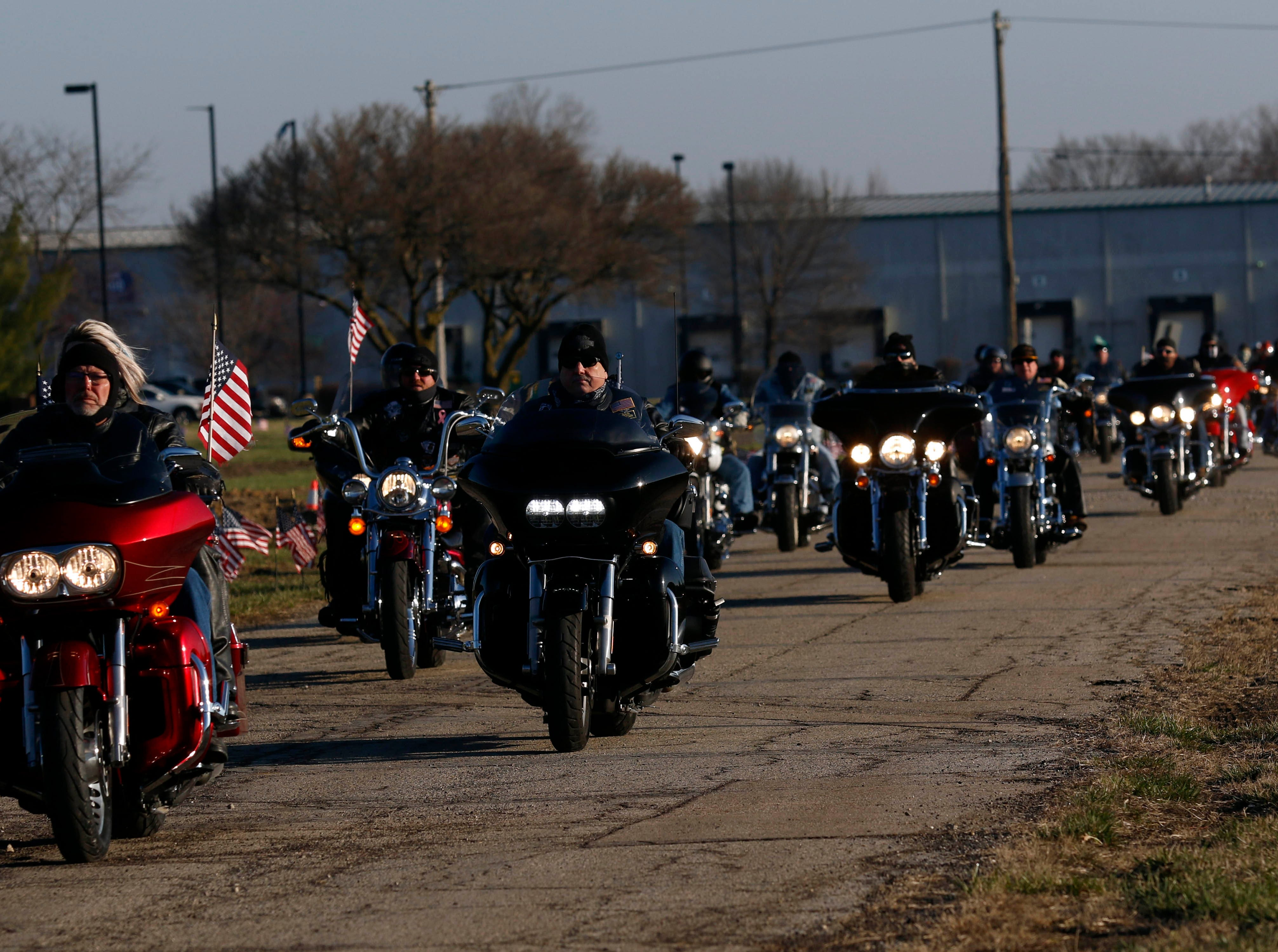 Hundereds of motorcycles approach Rickenbacker International Airport Wednesday, April 3, 2019, to escort the body of Sgt. Joseph Collette to Lancaster.
