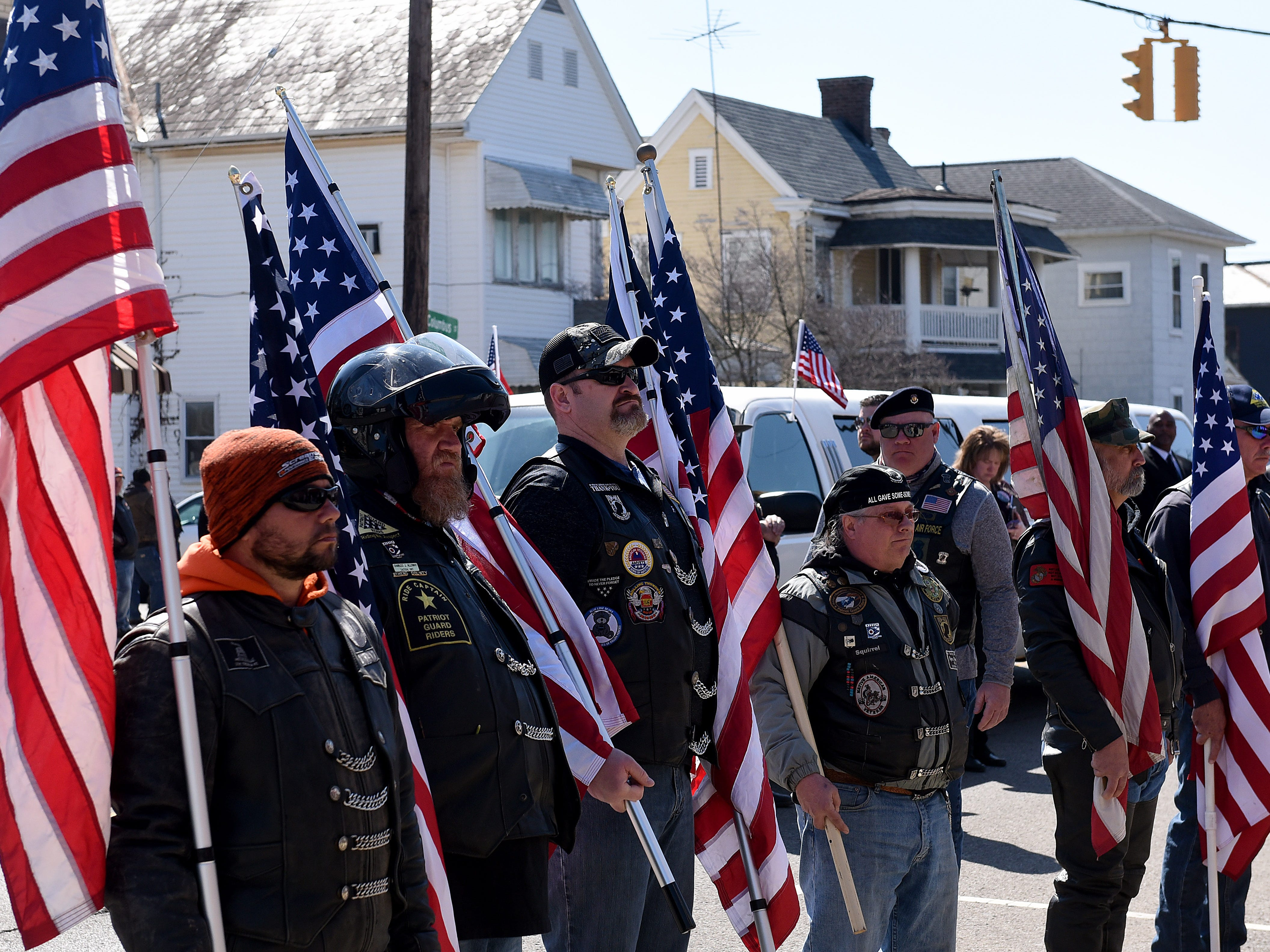 Patriot Guard Riders stand outside Frank E. Smith Funeral Home after a procession from Rickenbacker International Airport in Columbus. Over 300 cyclist joined the procession.