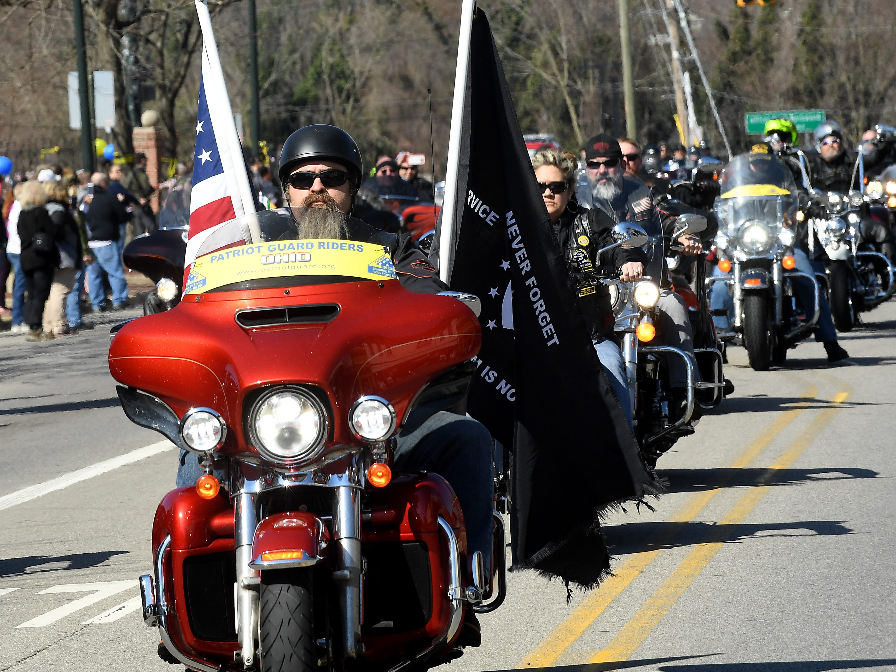 Patriot Guard Riders pass crowds lining Main Street in Lancaster as they escort the hearse carrying U.S. Army Sgt. Joseph Collette. More than 300 bikers provided an escort for the family.