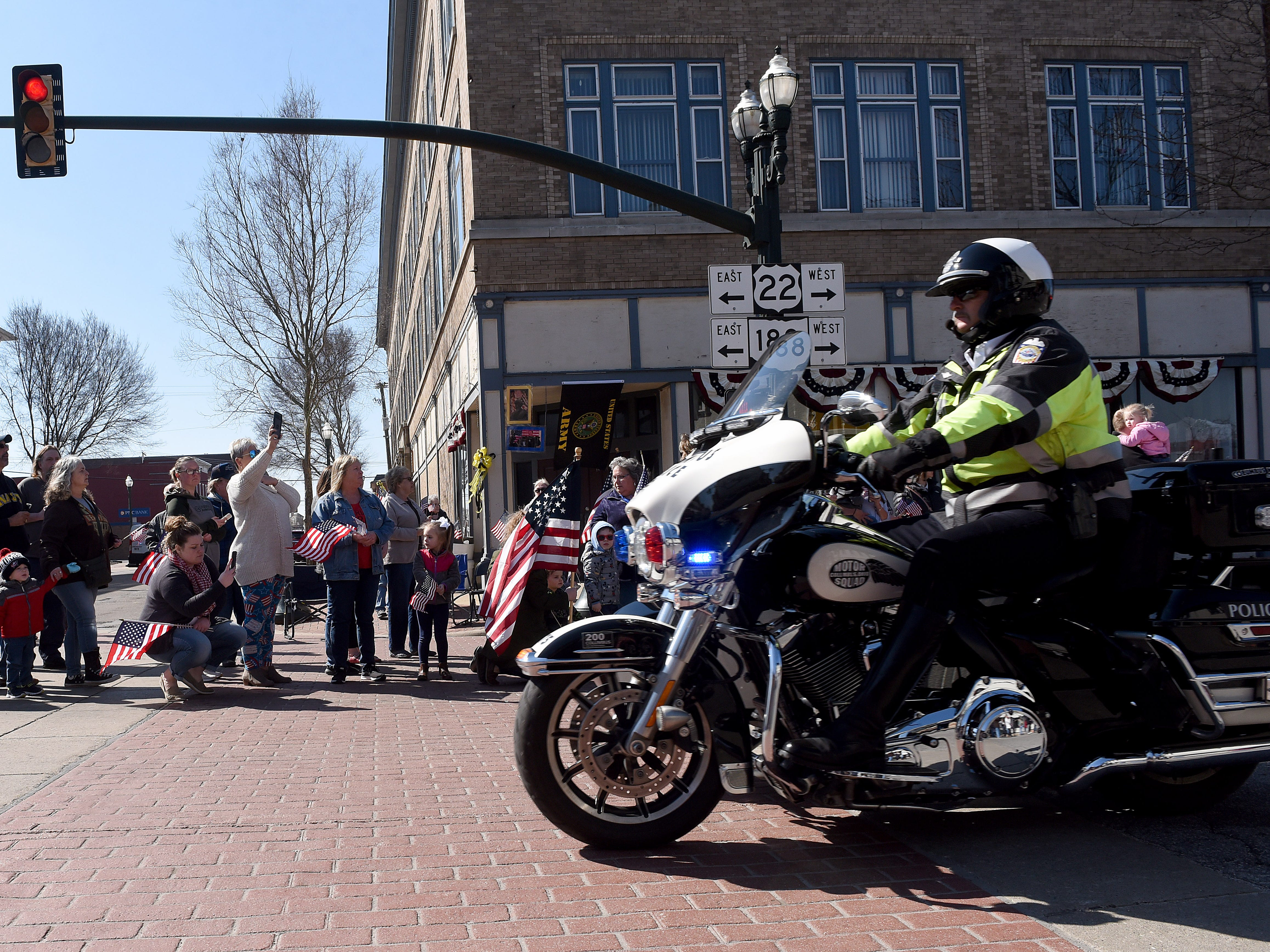 Motorcycles pass crowds lining Main Street in Lancaster as they escort the hearse carrying U.S. Army Sgt. Joseph Collette. More than 300 bikers provided an escort for the family.