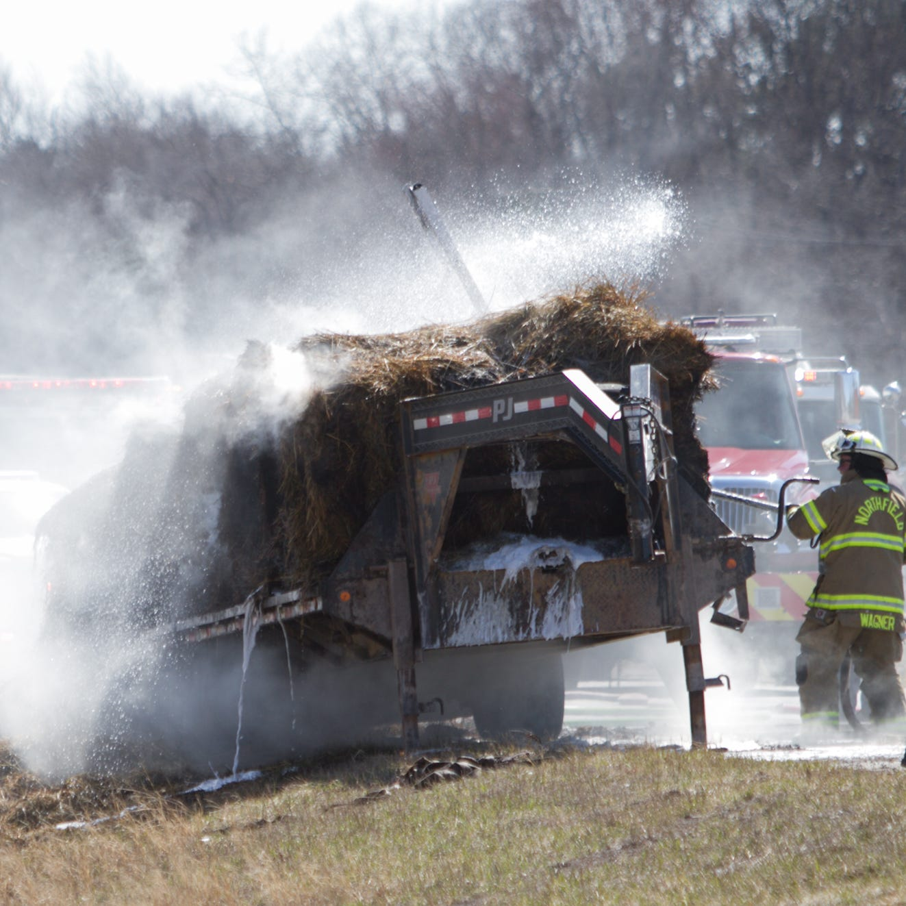 Northbound U.S. 23 closed near Silver Lake after trailer hauling hay catches fire