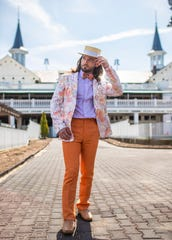 Model Josh Frank wears a multi confetti print on white paillette sparkling Tallia jacket ($195), orange Santorelli linen pants ($225), lavender E. B. Wood shirt ($60), orange plaid Judith Kushner bow tie ($70), with straw Vineyard Vines Boater ($118) during a Kentucky Derby fashion shoot at Churchill Downs. March 28, 2019