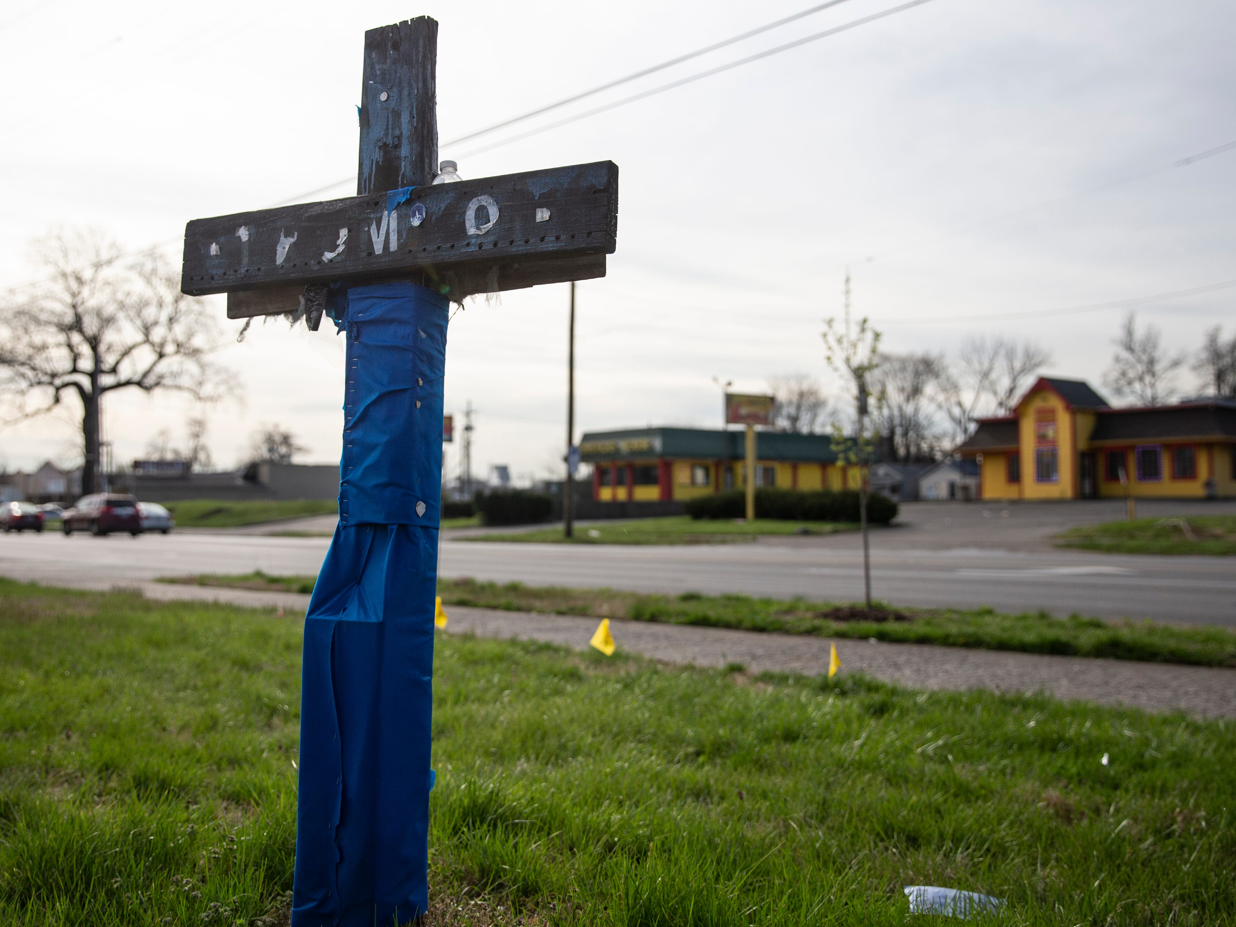 A decaying memorial cross is thought to be dedicated to a Brandon Trumbo, 16, who was shot and killed by another juvenile in a parking lot at Broadway at 22nd Street, in February 2008. April 2, 2019.