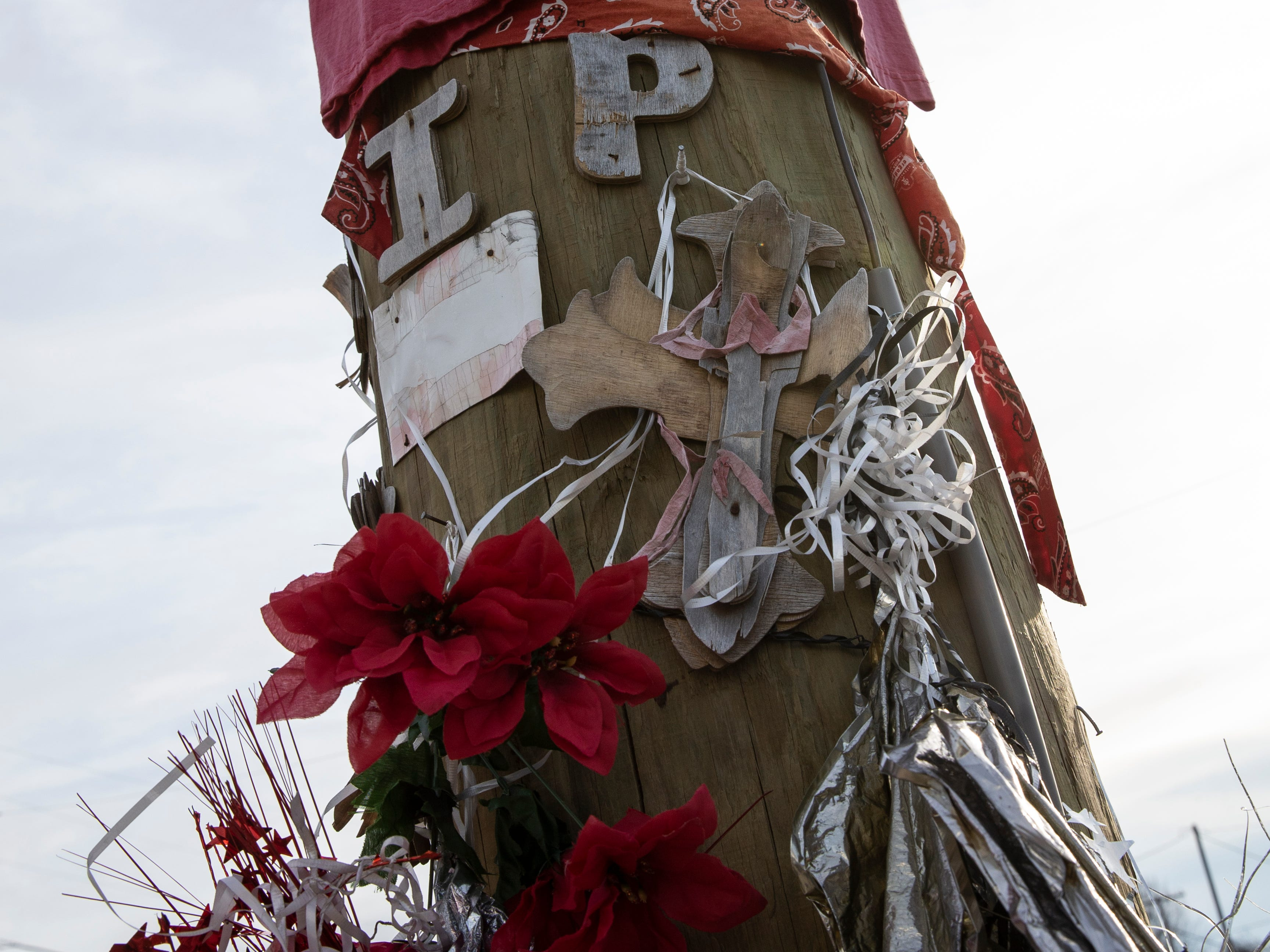 An aging memorial to the late Desmond Williams, 20, whose body was found in the middle of Dixie Highway at Gaulbert Avenue, in December of 2010.  April 2, 2019.