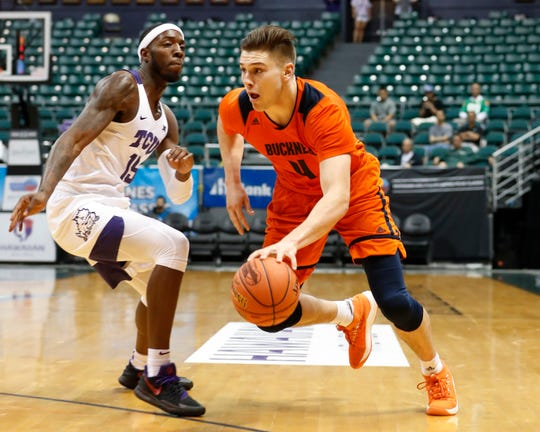 Bucknell forward Nate Sestina (4) dribbles past TCU forward JD Miller (15) during the first half of an NCAA college basketball game at the Diamond Head Classic, Sunday, Dec. 23, 2018, in Honolulu. (AP Photo/Marco Garcia)