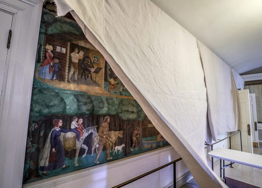 A Courier Journal photographer shows the mural that has been covered by the University of Kentucky's Memorial Hall after students protested and occupied the administration building.  UK President Eli Capilouto agreed to ongoing conversations about the future of the mural that depict images of slavery. April 3, 2019