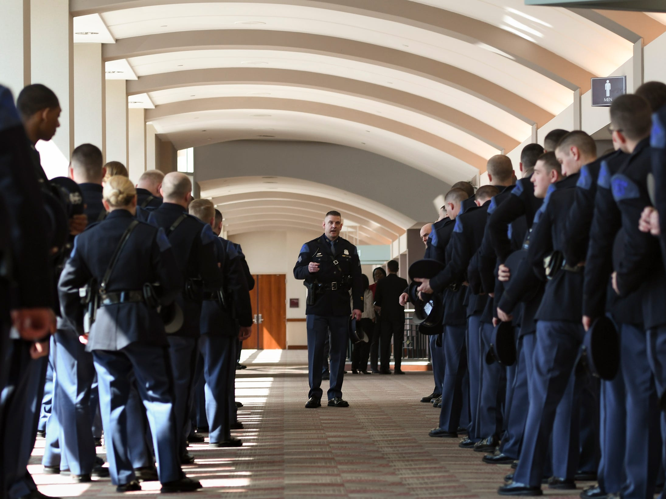 Michigan State Police Academy Commander Sgt. Cimmeron McRae speaks with members of the 135th Michigan State Police Trooper Recruit School prior to their cadence entry into the Lansing Center for graduation ceremonies and swearing in.  101 troopers graduated.