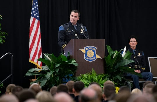 Michigan State Police Col. Joseph Gasper addresses new recruits Wednesday, April 3, 2019, during the 135th Michigan State Police Trooper Recruit School graduation at the Lansing Center in downtown Lansing.  101 new Michigan State Police state troopers were sworn in.