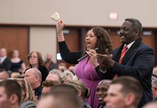 Linda and Kenneth Harden of Southfield react as their son, Michigan State Police Trooper Kenneth Harden II, receives his badge, Wednesday, April 3, 2019, during the 135th Michigan State Police Trooper Recruit School graduation at the Lansing Center in downtown Lansing.