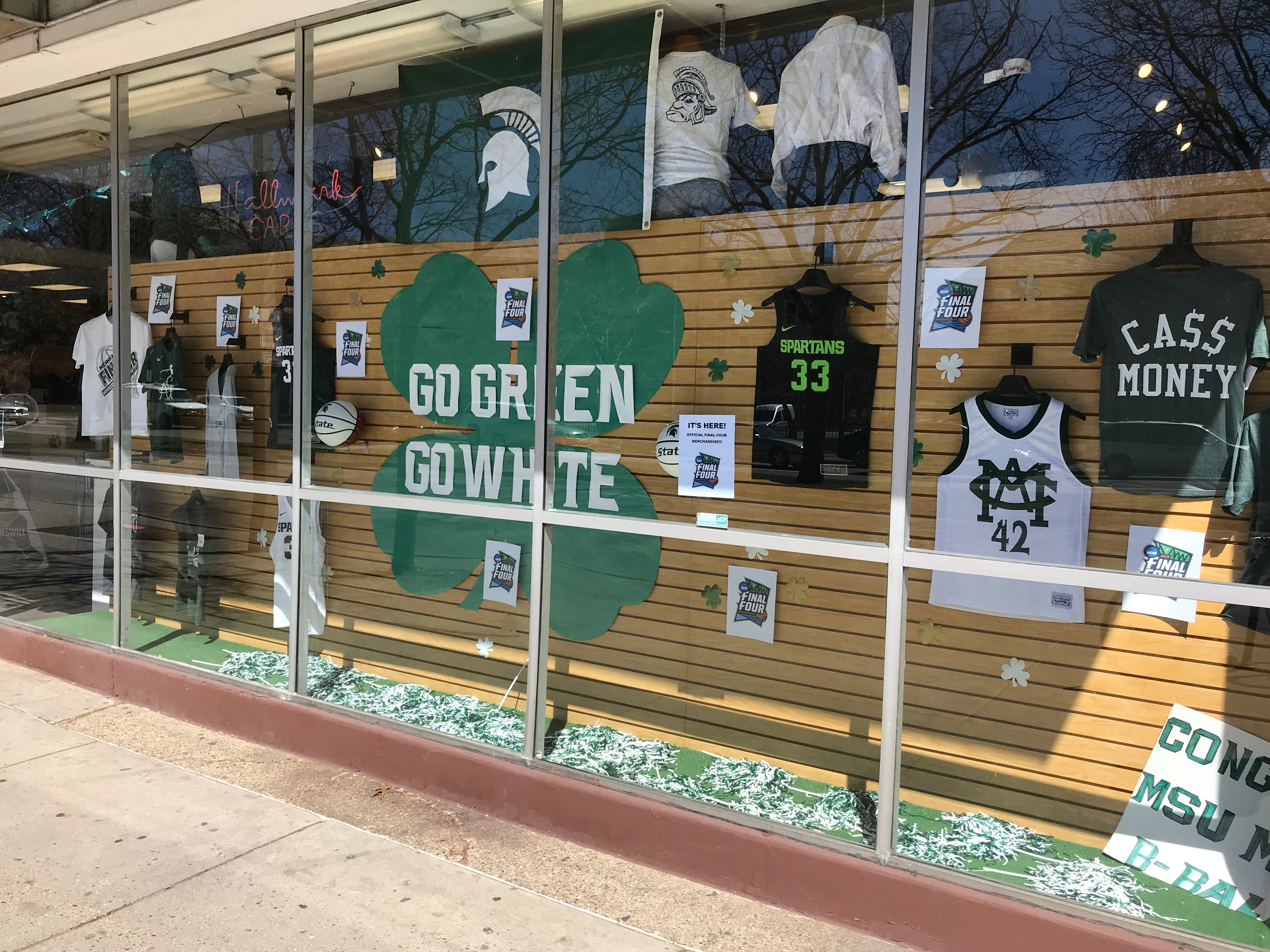 Display windows outside East Lansing's Student Book Store advertise Final Four merchandise. The store was busy Wednesday afternoon with MSU fans eager to spend.