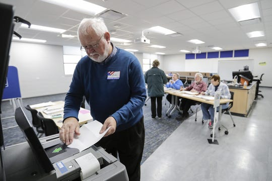 Poll worker Bob Jome feeds absentee ballots into the optical scanner for the local election at the UW-Green Bay Manitowoc campus Tuesday, April 2, 2019, in Manitowoc, Wis. Joshua Clark/USA TODAY NETWORK-Wisconsin