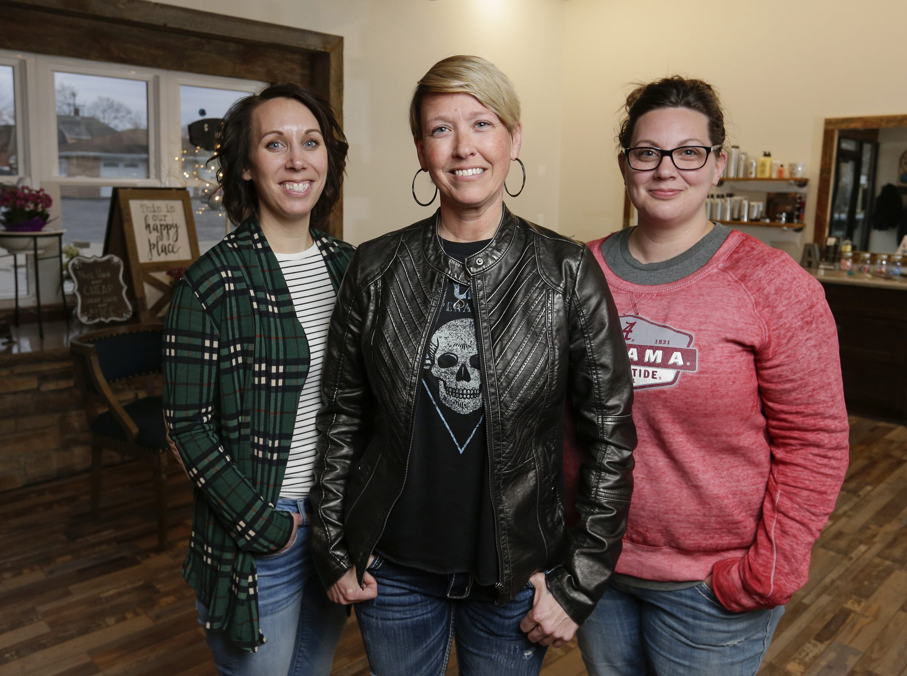 Kayla Fritsch (from left), Carrie Holton and Alicia Grimm, co-owners of the House of Bravo Salon, pose for a portrait in their recently opened business Monday, April 1, 2019, in Brillion, Wisconsin.