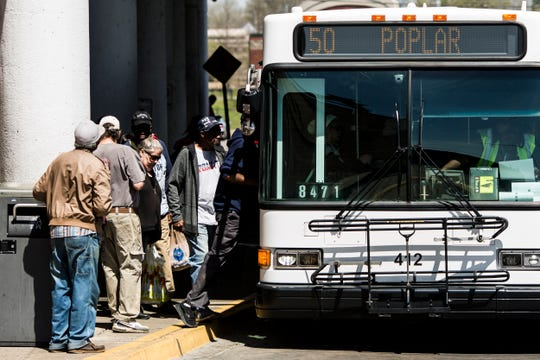 Riders board a MATA bus at the William Hudson Transit Center in downtown Memphis on April 3, 2019.