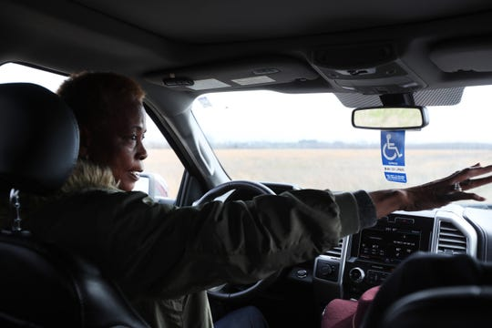 Everlyn Bryant, points out some of the land she previoulsy owned with her husband Joe Bryant Jr. near their family farming property in rural Arkansas on Thursday, Feb. 14, 2019.