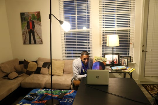 Bruce Elementary Principal Archie Moss reads a bedtime story to his students over Facebook Live, from his home on Tuesday, April 2, 2019. In an effort to boost students' interest in reading, Moss started the weekly ritual earlier this year, reading a new story every Tuesday night via the social media platform.