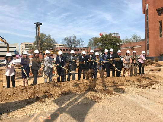 Shelby County Mayor Lee Harris, county commissioners and other officials break ground on a new Shelby County Health Department Wednesday.