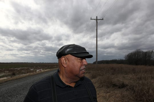 Joe Bryant Jr. looks over the site of his childhood home as he returns to the rural land he once farmed with his wife Everlyn in Allport, Arkansas, on Thursday, Feb. 14, 2019.