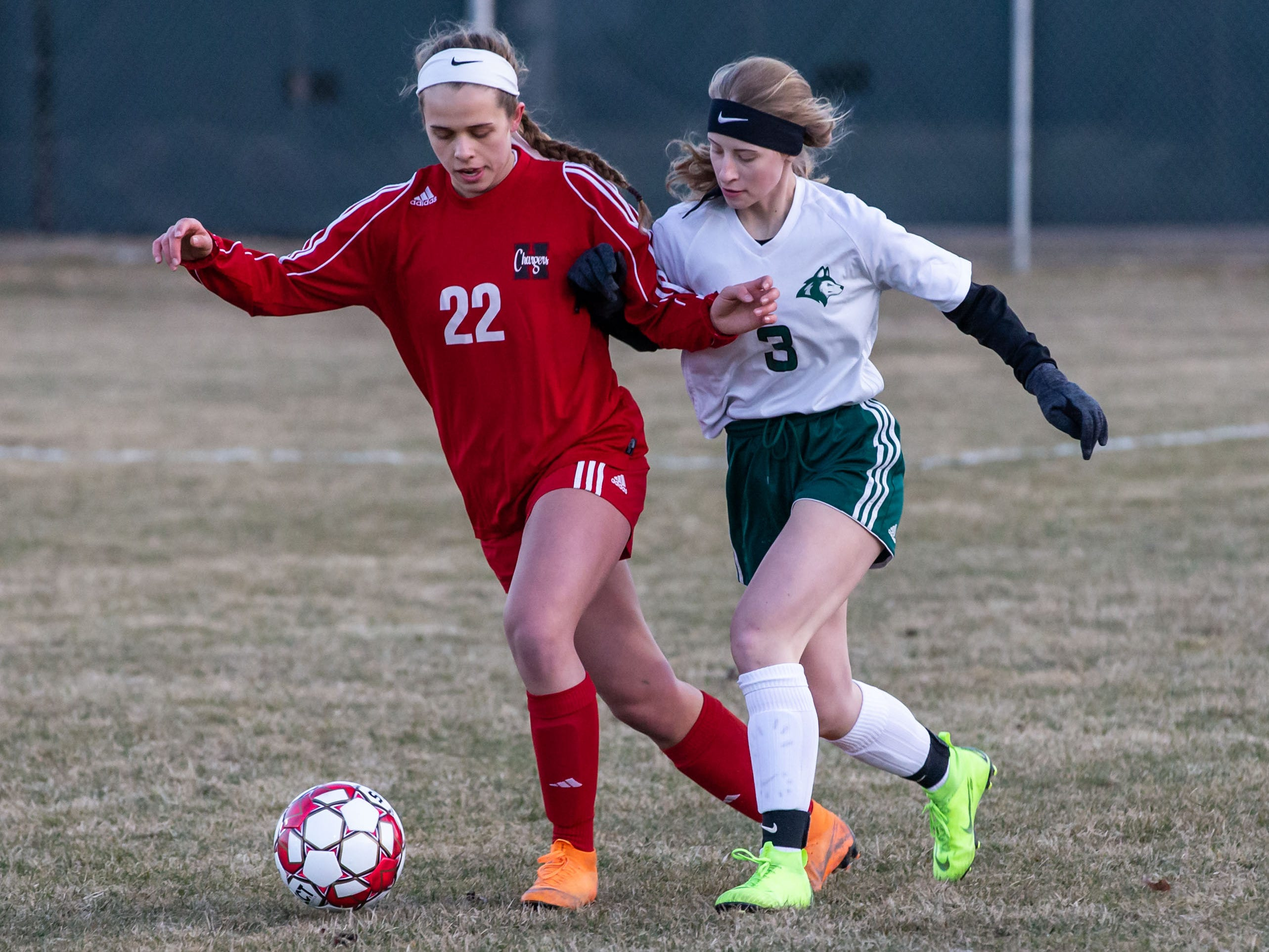 Hamilton's Mackenzie Leibiger (22) battles for possession with West Allis Hale's Madison Guidice (3) during the game at Hamilton on Tuesday, April 2, 2019.