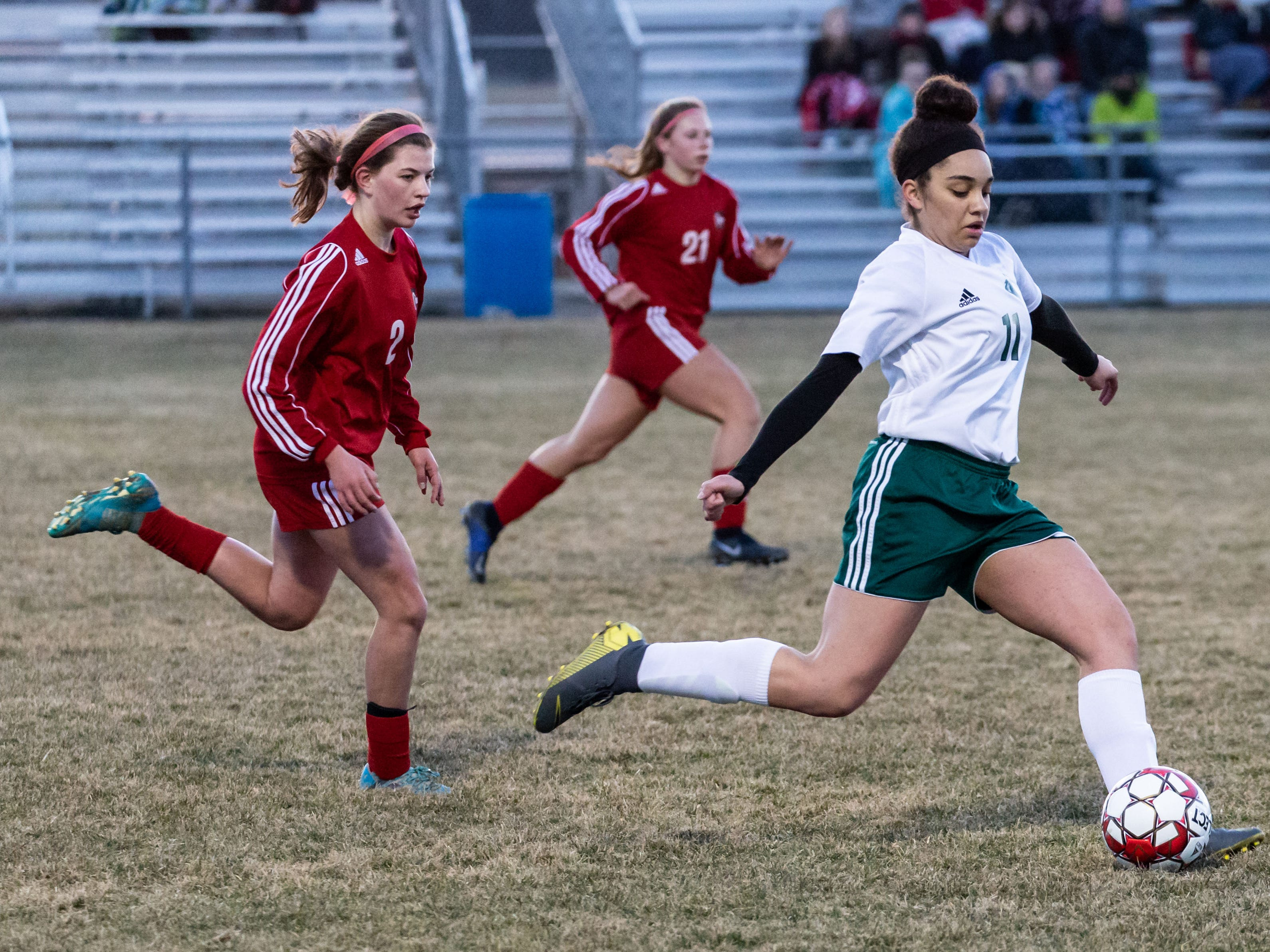 West Allis Hale's Naveah Gordon (11) sends one downfield during the game at Hamilton on Tuesday, April 2, 2019.