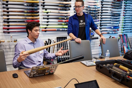 Christian Yelich (left) meets with Louisville Slugger product line manager Mike Butler when Yelich visited the Chicago corporate offices to discuss ideas for his custom bat Sept. 12, 2018.