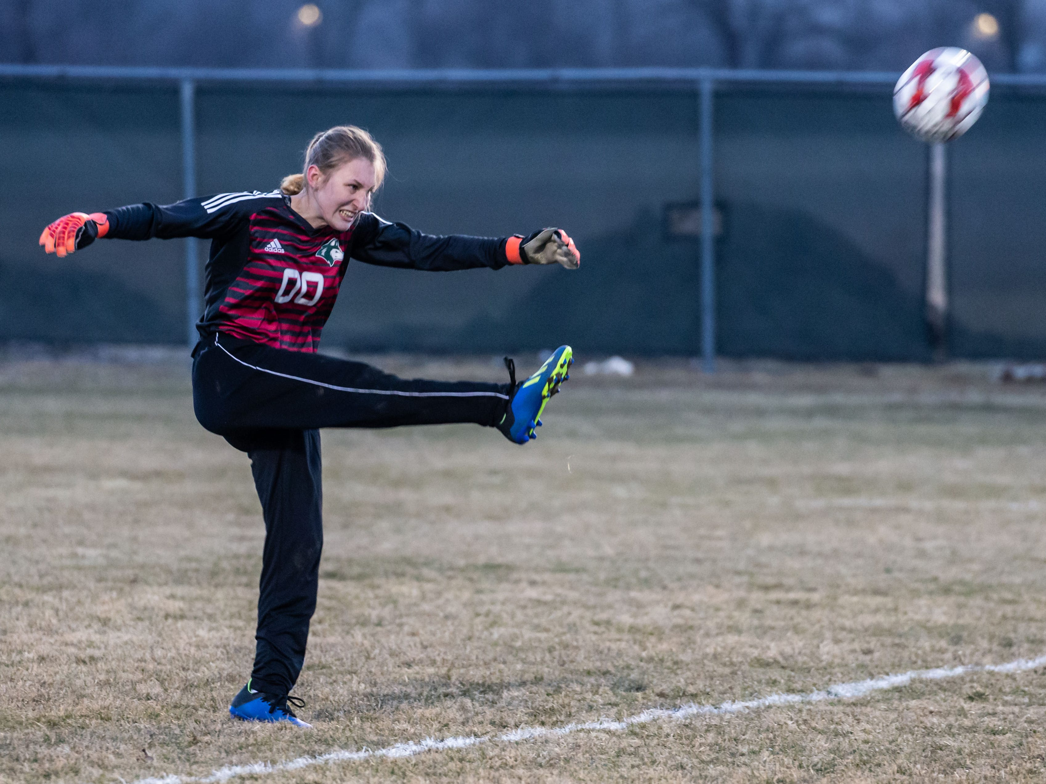 West Allis Hale's Abby Wargolet (00) kicks one downfield during the game at Hamilton on Tuesday, April 2, 2019.