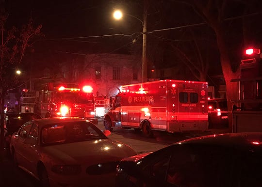 A fire truck and ambulance are parked on North Humboldt Avenue near a house fire that sent one resident to the hospital. Authorities said the cause of the fire was undetermined Tuesday night.