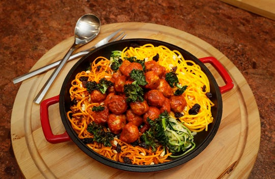 Veggie spirals, roasted kale and turkey meatballs in homemade sauce make this a special dish for Passover.