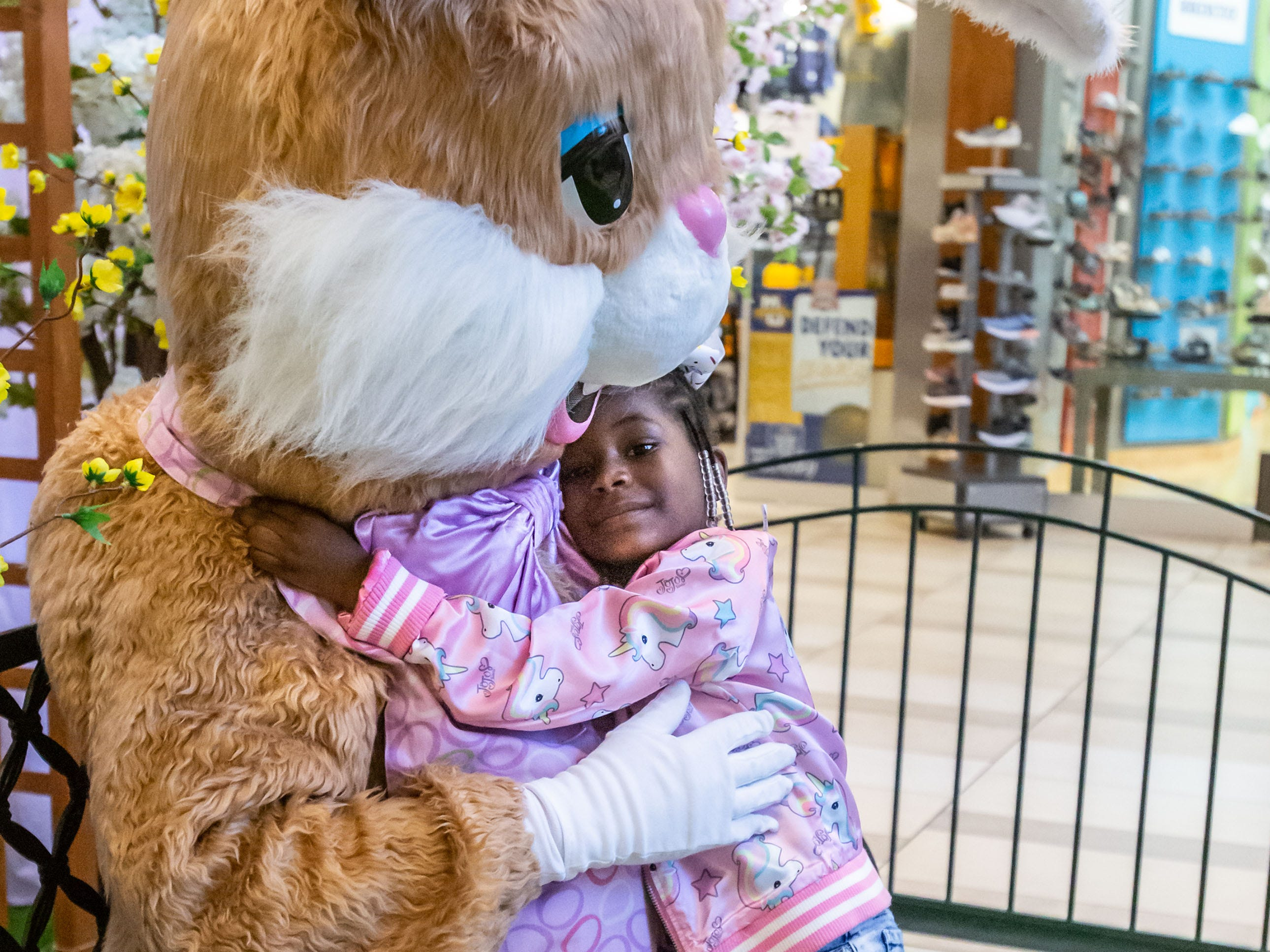 Four-year-old Aniyah Bingham of Milwaukee gives the Easter Bunny a hug at Center Court in Brookfield Square Mall on Monday, April 1, 2019. The bunny will be at the mall Monday through Saturday 10am - 9pm and Sunday 11am - 6pm through Saturday, April 20. Pets are welcome to visit from 6-9pm on Monday, April 1, 8 & 15.