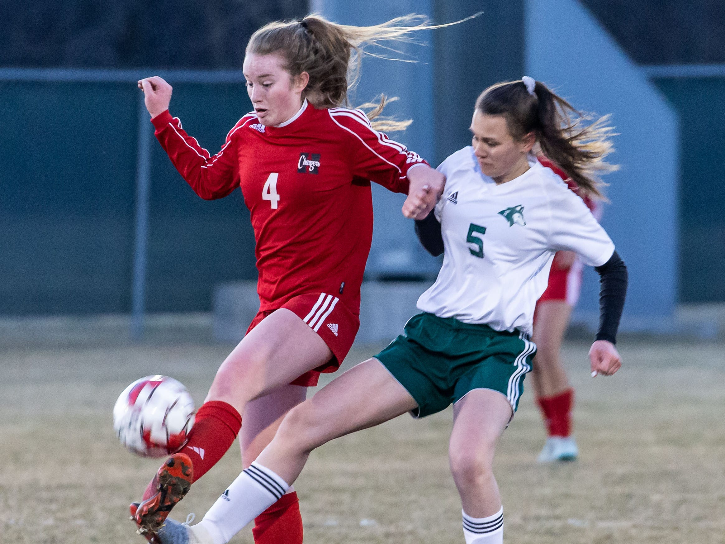 Hamilton's Maddie Wrobleski (4) battles for possession with West Allis Hale's Abby Marek (5) during the game at Hamilton on Tuesday, April 2, 2019.