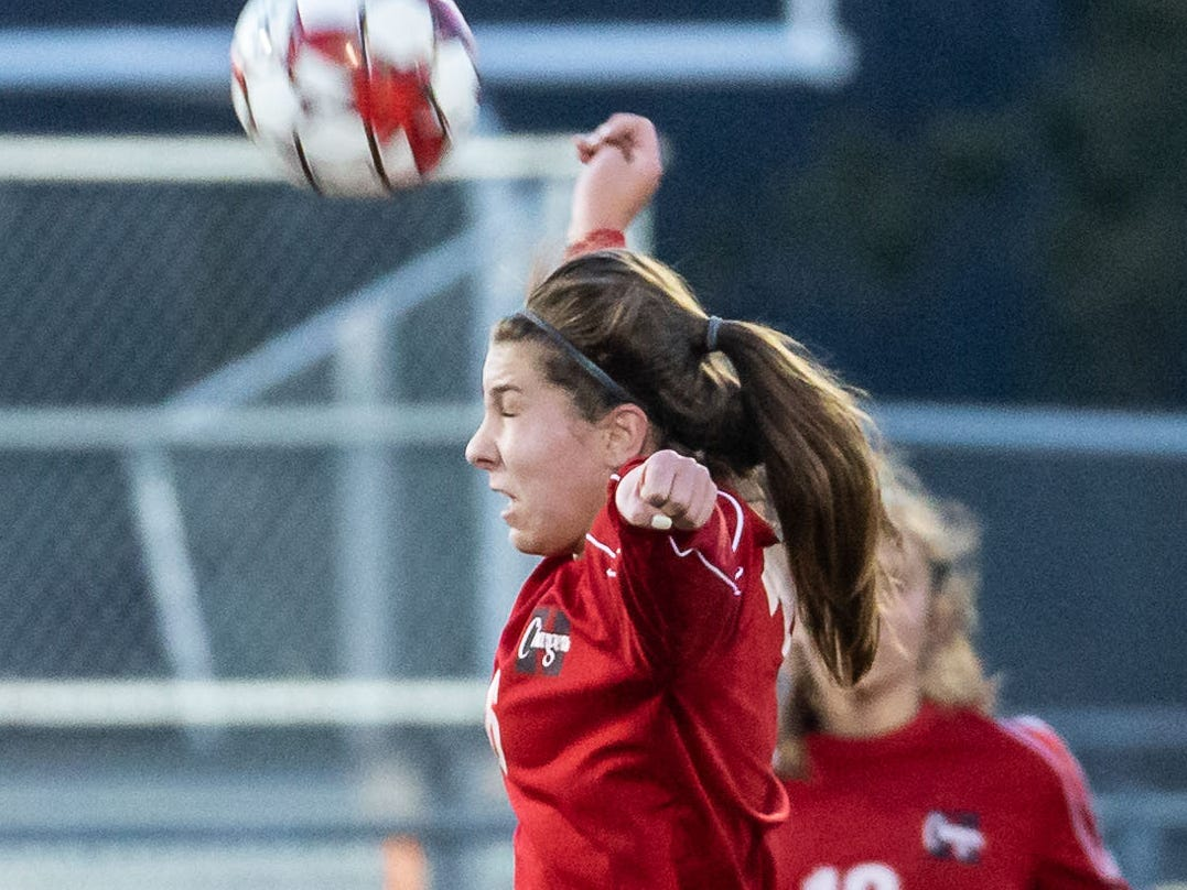 Hamilton's Amanda Seidl (16) elevates for a header during the game at home against West Allis Hale on Tuesday, April 2, 2019.