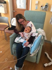 Whitney McLean holds her son Marcus Albers at Children's Hospital of Wisconsin. Marcus needs a liver transplant to live.
