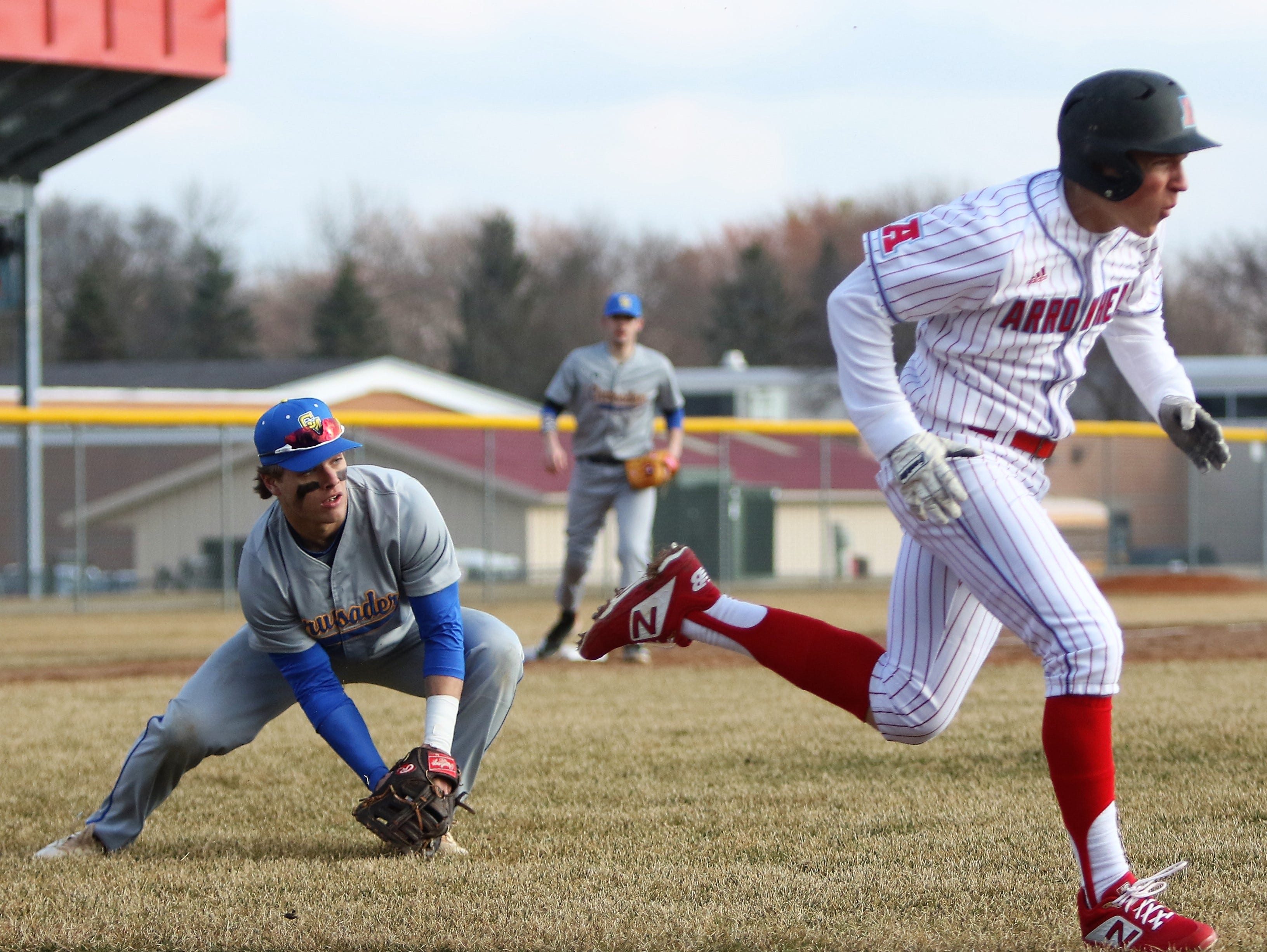 Catholic Memorial first baseman Alex Cyskiewicz fields a bunt by Arrowhead's Tyler Loebel during a game on April 2, 2019.