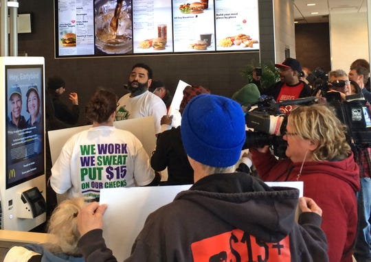 Members of the Fight for $15 campaign, the drive for a minimum wage of $15 an hour, held a brief protest at the McDonald's restaurant at 617 W. Oklahoma Ave. in Milwaukee Wednesday as part of protests scheduled in 10 cities. People with the campaign said the protests were to tell the company that its decision to stop lobbying against minimum wage increases was not enough.