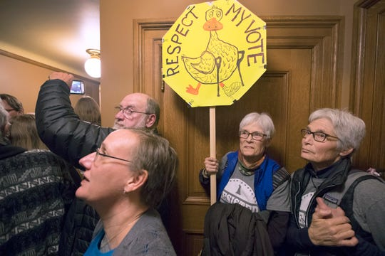 People crowding a hallway vent their anger outside a lame-duck session of the Joint Finance Committee last Dec. 3 at the Capitol in Madison.