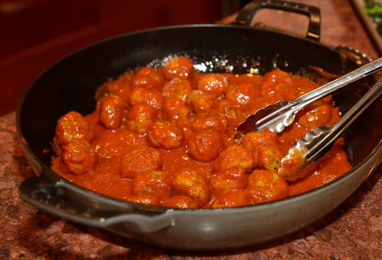 Turkey meatballs are heated in a homemade tomato sauce.
