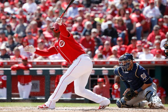 Reds pinch-hitter Yasiel Puig strikes out on a curveball from Brewers starter Freddy Peralta the landed in the dirt, forcing catcher Manny Pina to block the pitch and tag Puig for the final out of the eighth inning.