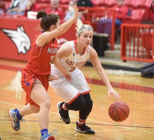 Norfork's Whitlee Layne drives past Melbourne's Reagan Rapert during tournament action at Flippin early in the season. Layne and Rapert were both voted onto the Arkansas Sports Media Basketball Super Team on Tuesday evening.