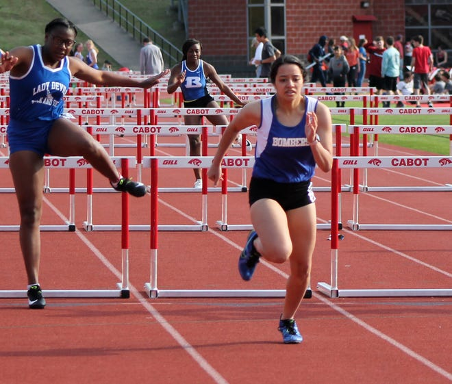 Mountain Home's Jaden Chapa finishes the 100-meter hurdles on Tuesday at Cabot.