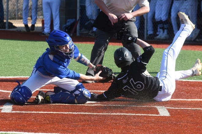 Jonesboro's Jacob Wheatherley slides past the tag of Mountain Home catcher Garrett Steelman during 5A-East Conference action Tuesday evening.