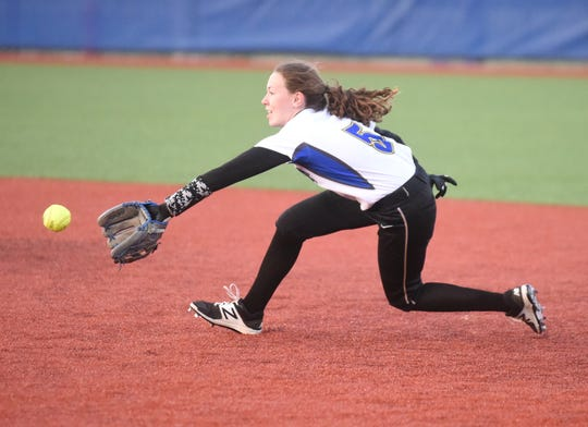Mountain Home's Emily Payne dives for the ball during the Lady Bombers' 11-0 win over Jonesboro on Tuesday night.