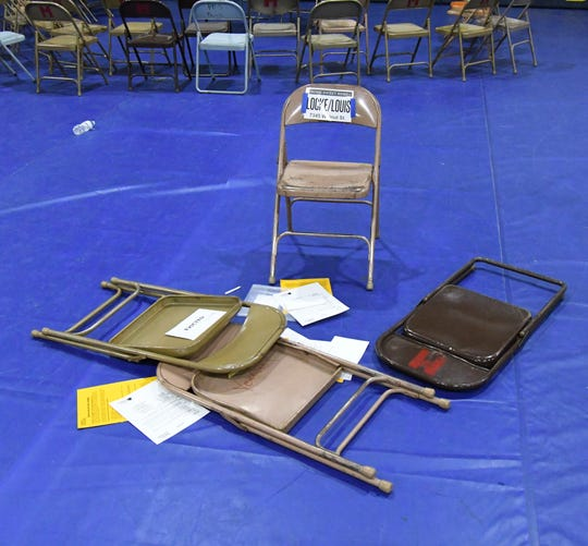 Folded chairs represent a household that has been evicted during Wednesday's poverty simulation at Mountain Home High School.