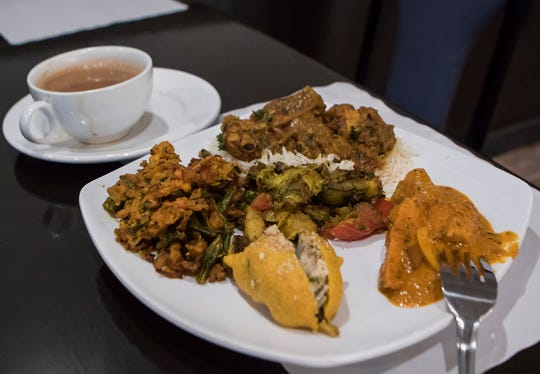A plate is laden with food from the Little India restaurant in Monroe, La. lunch buffet. The newly opened restaurant features a full menu of Indian cuisine and a lunch buffet from 11 a.m. - 2:30 p.m. Tuesday- Sunday.