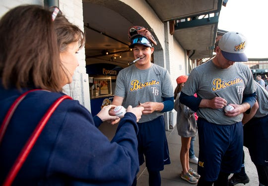 Montgomery Biscuits players sign autographs after their workout at Riverwalk Stadium in Montgomery, Ala., on Tuesday April 2, 2019. The first home game of the season for the Biscuits in Wednesday April 10th.